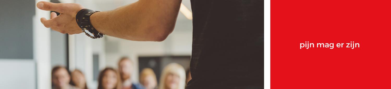 Spreken over pijnmanagement op bijeenkomst